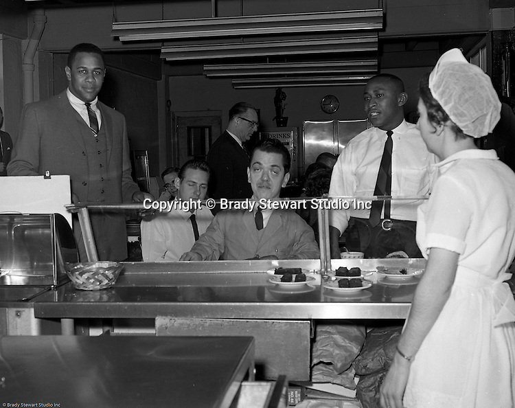 Pittsburgh PA:  Willie Stargell getting a tour of the Goodwill Industries facility - 1966.  Willie and many other Pittsburgh Pirates were very involved in the community supporting charitable causes.<br />