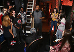 """James Monroe Iglehart with students backstage before The Rockefeller Foundation and The Gilder Lehrman Institute of American History sponsored High School student #EduHam matinee performance of """"Hamilton"""" at the Richard Rodgers Theatre on October 25, 2017 in New York City."""