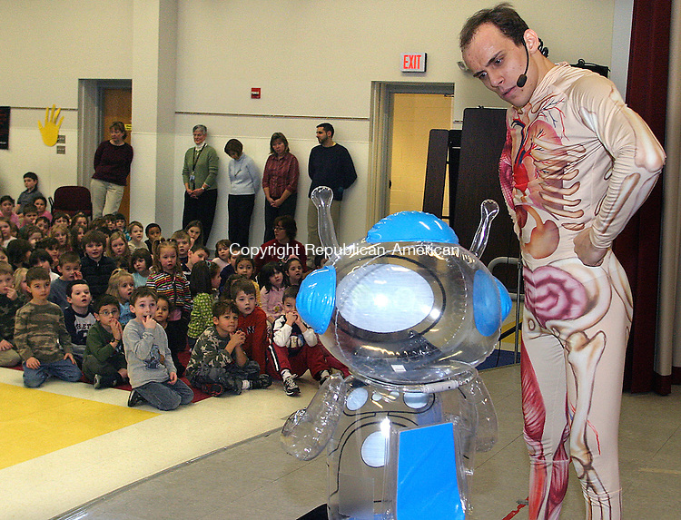 THOMASTON, CT. 23 JANUARY 05_NEW_020409DA01.jpg- Ethan Angelica, of the Bronx NY, portrays Mr. Slim Goodbody during a musical health show Wednesday at Black Rock School in Thomaston. The show teaches children about different parts of the human body.<br />  Darlene Douty