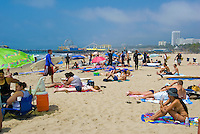 Santa Monica, CA, Holiday, Crowd, Walking, playing, Beach, Umbrellas, California, USA,
