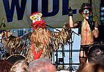 """Bobbie Haven of South County was dressed as a Wookie for the """"most hairy"""" category of the costume contest at the 11th Annual World Naked Bike Ride which was held Saturday in The Grove. At right is contest emcee Maxi Glamour Hundreds of participants wore nothing or next to nothing before, during and after the bicycle ride. There was also a drag show, music, food, vendor booths, and dancing.   Photo by Tim Vizer"""