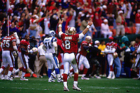 SAN FRANCISCO, CA - Quarterback Steve Young of the San Francisco 49ers signals touchdown with his arms in the air during a game against the Carolina Panthers at Candlestick Park in San Francisco, California in 1996. Photo by Brad Mangin