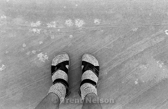 Trent feet and rock at Arches National Park<br />