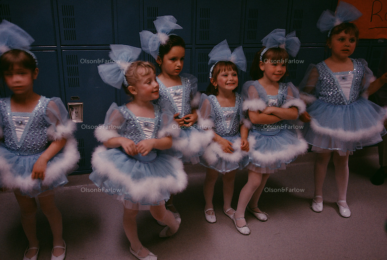 Little ballerinas wait to go on stage at the annual recital attended by hundreds.  After the New Jersey wetlands was cleared, the town of Secaucus developed into pig farms. The farms have been replaced by warehouses and malls and the town's population triples during the day. Cultural and community activities are most important to families who make Secaucus their home.