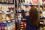 Woman at a grocery store in organic products section Canada