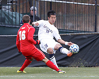 University of Connecticut defender Flo Liu (16) crosses the ball. .NCAA Tournament. With a goal in the second overtime, University of Connecticut (white) defeated University of New Mexico (red), 2-1, at Morrone Stadium at University of Connecticut on November 25, 2012.