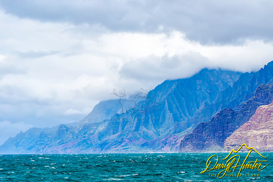 Na Pali Coast of Kauai.  Kauai's famous coastline is truly majestic, featuring emerald green pinnacles towering along the shoreline for 17-miles. Located on the North Shore of Kauai, the Napali Coast features panoramic views of the vast Pacific Ocean, velvet green cliffs and cascading waterfalls plummeting into deep, narrow valleys. The rugged terrain appears much as it did centuries ago when Hawaiian settlements flourished in these valleys existing only on the food they could grow and the fish they could catch.