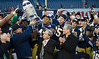 Dec. 28, 2013; The Football team hold the Pinstripe Bowl trophy after defeating Rutgers 29-16 in the Pinstripe Bowl in Yankee Stadium.<br /> <br /> Photo by Matt Cashore