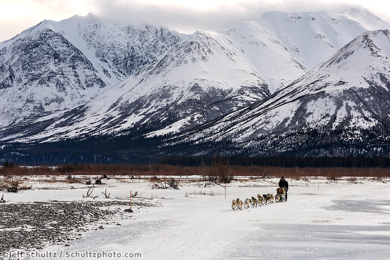 Melissa Owens-Stewart on the trail on the South Fork of the Kuskokwim River after leaving the Rohn checkpoint during Iditarod 2016.  Alaska.  March 08, 2016.  <br /> <br /> Photo by Jeff Schultz (C) 2016 ALL RIGHTS RESERVED