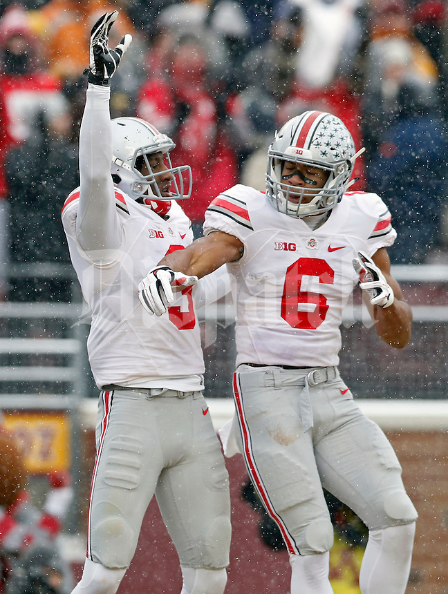 Ohio State Buckeyes wide receiver Michael Thomas (3) celebrates his touchdown catch with Ohio State Buckeyes wide receiver Evan Spencer (6) during the 3rd quarter at TCF Bank Stadium in Minneapolis, Minn. on November 15, 2014.  (Dispatch photo by Kyle Robertson)