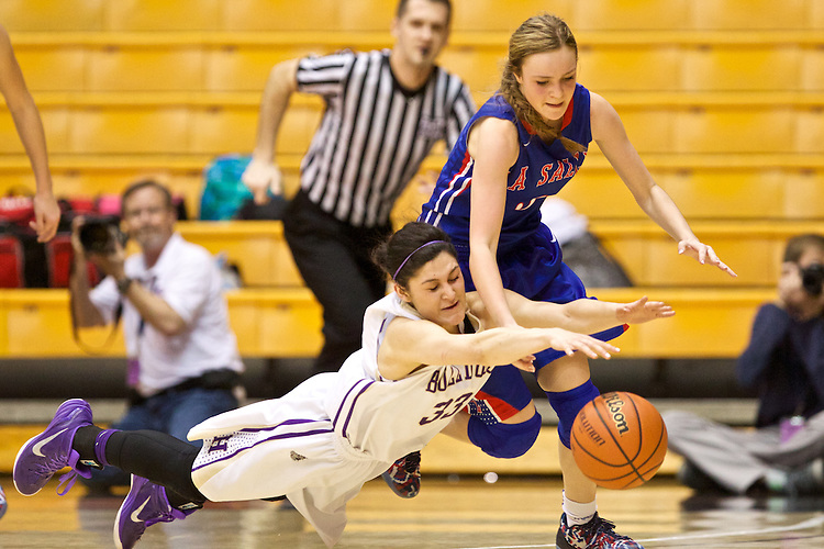 Mar 11, 2015; Portland, OR, USA; La Salle Prep guard Taycee Wedin and Hermiston Bulldogs guard Sara Ramirez dive for a loose ball in the 5A Girls Basketball State Championship at Gill Coliseum.<br /> Photo by Jaime Valdez