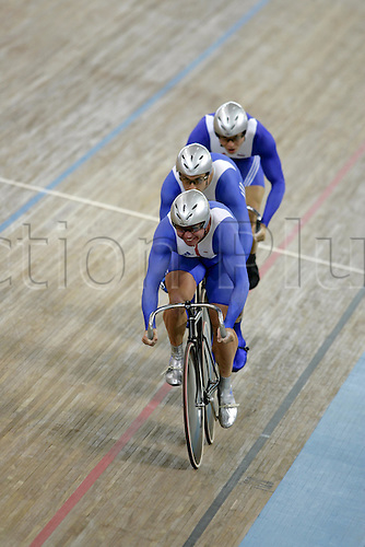 21 August 2004: The British team of Chris Hoy, Craig Maclean and Jamie Staff in action during heat 4 of the Men's Team Sprint Qualifying held at The Olympic Velodrome. 2004 Olympic Games, Athens, Greece. Photo: Neil Tingle/Action Plus...040821 olympics olympic bicycle bike track cycling velodrome team work teamwork