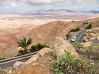 Spain, ESP, Canary Islands, Fuerteventura, Mirador de Morro Velosa, 2012Oct14: A view from the mountain across the mountain road FV-30 down to the valley.