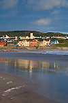 The seaside, golfing and surf town of Lahinch, Co. Clare, Ireland, reflection in the water at sunset