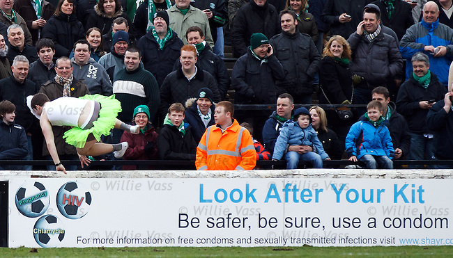 Hibs fan in a tutu and Jedward mask running across the pitch at half time and vaults the wall