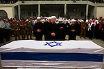 Israeli Druse mourn over the flag-draped coffin of 21-year-old Staff Sergeant Sayaf Bisan during his funeral in the Druse village of Jat, northern Israel, Wednesday April 9, 2008. Bisan was killed early Wednesday in clashes in the southern Gaza Strip during an operation against Palestinian militants in the area.Daniel Bar - On \ Jini