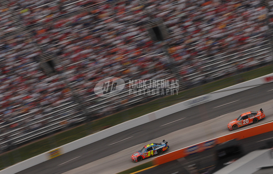 Apr 1, 2007; Martinsville, VA, USA; Nascar Nextel Cup Series driver Jeff Gordon (24) leads Tony Stewart (20) during the Goody's Cool Orange 500 at Martinsville Speedway. Martinsville marks the second race for the new car of tomorrow. Mandatory Credit: Mark J. Rebilas
