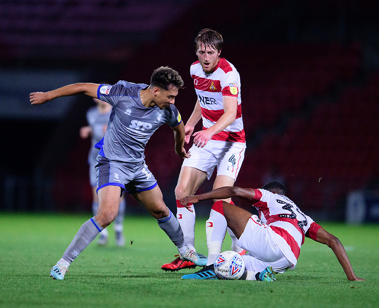 Lincoln City's Tyler Walker battles with Doncaster Rovers' Tom Anderson, left, and Cameron John<br /> <br /> Photographer Andrew Vaughan/CameraSport<br /> <br /> EFL Leasing.com Trophy - Northern Section - Group H - Doncaster Rovers v Lincoln City - Tuesday 3rd September 2019 - Keepmoat Stadium - Doncaster<br />  <br /> World Copyright © 2018 CameraSport. All rights reserved. 43 Linden Ave. Countesthorpe. Leicester. England. LE8 5PG - Tel: +44 (0) 116 277 4147 - admin@camerasport.com - www.camerasport.com