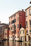 ITALY, Venice.  View of homes and bridge over a canal in the Castello district. Castello is the largest of the six sestieri of Venice.