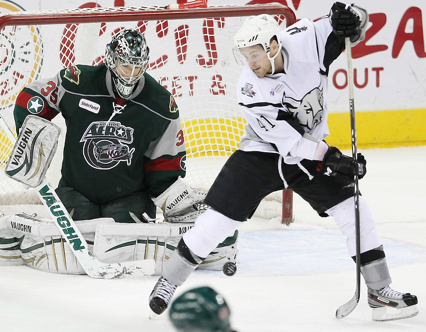 San Antonio Rampage's David Marshall, right, deflects the puck toward Houston Aeros goaltender Darcy Kuemper during the third period of an AHL hockey game, Tuesday, Dec. 6, 2011, in San Antonio. Houston won 6-1. (Darren Abate/pressphotointl.com)