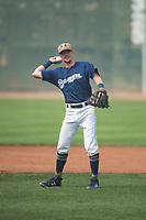 Helena Brewers infielder Brice Turang (18) throws the ball around the infield between batters during a Pioneer League game against the Grand Junction Rockies at Kindrick Legion Field on August 19, 2018 in Helena, Montana. The Grand Junction Rockies defeated the Helena Brewers by a score of 6-1. (Zachary Lucy/Four Seam Images)