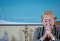 PQ leader Pauline Marois looks pensive as she talk to a reporter during a site down interview at her office in the National Assembly in Quebec City Tuesday April 12, 2011.