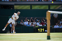 Novak Djokovic (SRB) serves during the Gentlemen's Singles Final against Kevin Anderson (RSA)