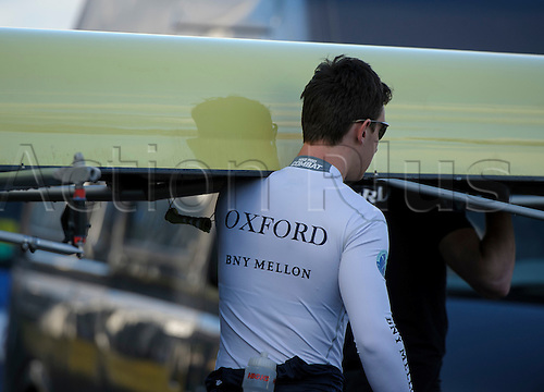 19.01.2014. River Thames, London, England. Oxford University Boat Club Trial VIIIs, Sponsors detail as the crew launch the boat. The Trial serves as part of the selection process to determine who will represent Oxford University in the 160th running of the University Boat Race on April 6th 2014. The trial for the two eights, named Persistent and Stubborn is the only occasion during the season that the squad members can race side-by-side over the full four and a quarter miles of the Championship Course between Putney and Mortlake in a simulation of The BNY Mellon Boat Race.