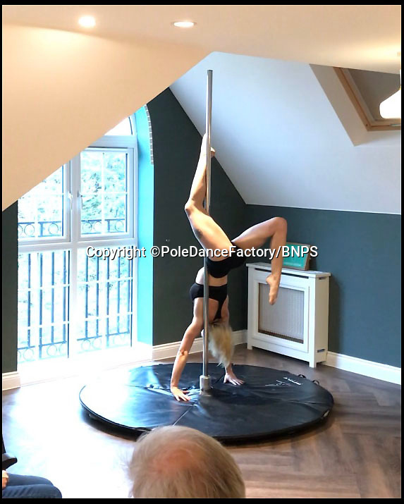 BNPS.co.uk (01202 558833)Pic: PoleDanceFactory/BNPS<br /> <br /> Old peoples home treated to live pole dance show.<br /> <br />  A care home has raised eyebrows for providing pole dancing entertainment for its elderly residents. <br /> <br /> The Fairmile Grange home in Christchurch, Dorset, organised the 'inappropriate' activity that is usually associated with lapdancing clubs for male and female pensioners, some of whom have dementia. <br /> <br /> But bosses have defended the choice of entertainment, saying its residents 'wanted something a bit different'.<br /> <br /> A video of the performance shows a young woman in a skin coloured leotard doing acrobatic manoeuvres on the pole as residents watch on.