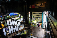 Astoria New York - 7 April 2016 Green subways wait beneath the stairs of an elevate subway station in Queens, NewYork. ©Stacy Walsh Rosenstock
