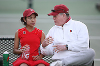 STANFORD, CA - JANUARY 28:  Frank Brennan Sr. of the Stanford Cardinal talks with Hilary Barte during Stanford's 7-0 win over the UC Davis Aggies on January 28, 2009 at the Taube Family Tennis Stadium in Stanford, California.