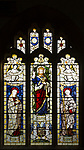 Saint Bernard, Jesus Christ, Blessed Virgin Mary depicted in stained glass window by Burlisson and Grylls 1906, All Saints church, Stanton St Bernard, Wiltshire,