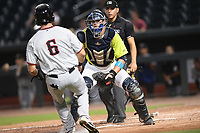 Catcher Hayden Senger (15) of the Columbia Fireflies holds the ball and makes an easy putout tag on Ryan Anderson (6) of the Hickory Crawdads in a game on Wednesday, August 28, 2019, at Segra Park in Columbia, South Carolina. Hickory won, 7-0. (Tom Priddy/Four Seam Images)