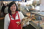 Woman with crab at Fisherman's Wharf