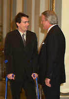 Montreal, April 4rd 2001<br /> Quebecor President and CEO and Vice-Chairman of the Board of Quebecor World ; Pierre-Karl Peladeau (left) on crutches after a skiing accident in Europe speak with Sun Media Corp Chairman of the Board ;  The Right Honorable Brian Mulroney after the<br /> Quebecor World annual meeting, April 4th 2001, in Montreal, CANADA<br /> <br /> Since the `` Merger of equals `` between Quebecor Printing and World Color, the company operating margin reached a record high of 11.1 % for the year ; revenues increased by 32 % to 6.5 billion US $ ; operating income increased by 53 % to 724.8 Million US $  and net income increased by 43 % to 293.4 Million US $, or 1,93 US $ per share.<br /> <br /> Quebecor World is now the largest and strongest performing entity in the printing field<br /> Photo by Pierre Roussel  /I Photo<br /> NOTE :  D-1 photo uncorrected