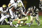 Torrance, CA 11/05/10 - Joey Notch (West # 10), Okuoma Idah (Peninsula #24), Mickey O'crowley (Peninsula #53) and unknown Peninsula player in action during the Peninsula vs West varsity football game played at West Torrance high school.
