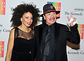 Carlos Santana and Cindy Blackman arrive for the formal Artist's Dinner honoring the recipients of the 2013 Kennedy Center Honors hosted by United States Secretary of State John F. Kerry at the U.S. Department of State in Washington, D.C. on Saturday, December 7, 2013. The 2013 honorees are: opera singer Martina Arroyo; pianist,  keyboardist, bandleader and composer Herbie Hancock; pianist, singer and songwriter Billy Joel; actress Shirley MacLaine; and musician and songwriter Carlos Santana.<br /> Credit: Ron Sachs / CNP