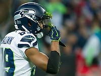 Seattle Seahawks Wide Receiver Doug Baldwin (89) removes grass from his helmet