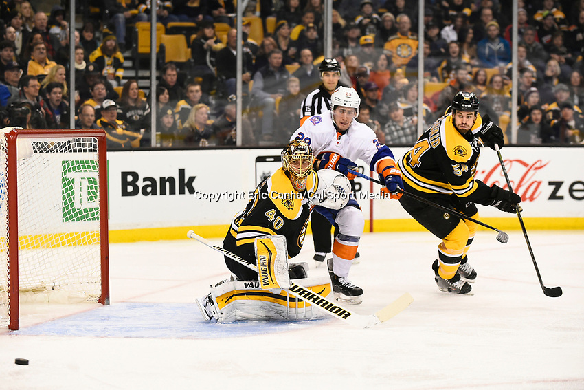 February 7, 2015 - Boston, Massachusetts, U.S. - Boston Bruins goalie Tuukka Rask (40), defenseman Adam McQuaid (54) and New York Islanders center Brock Nelson (29) all watch the puck's deflection during the NHL game between the New York Islanders and the Boston Bruins held at TD Garden in Boston Massachusetts. The Bruins defeated the Islanders 2-1 in regulation time. Eric Canha/CSM