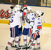 January 9th, 2009:  Stefan Meyer (10) of the Rochester Amerks is congratulated by Janis Sprukts (5), Cory Murphy (28) and Tanner Glass (back) after a goal during the first period vs. the Syracuse Crunch at Blue Cross Arena in Rochester, NY.  Rochester defeated Syracuse 3-1 for their third straight win.  Photo Copyright Mike Janes Photography 2009