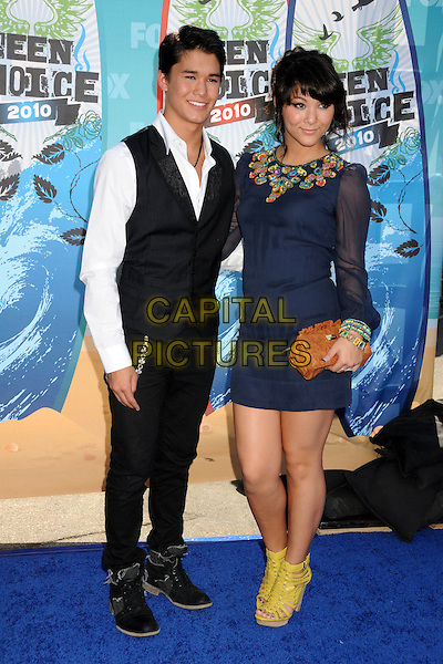 BOOBOO STEWART & FIVEL STEWART .Teen Choice Awards 2010 - Arrivals held at Universal Studios Gibson Amphitheatre, Universal City, California, USA..August 8th, 2010 .full length blue sheer dress sleeves brown clutch bag white shirt black waistcoat sister brother family yellow strappy sandals .CAP/ADM/BP.©Byron Purvis/AdMedia/Capital Pictures.