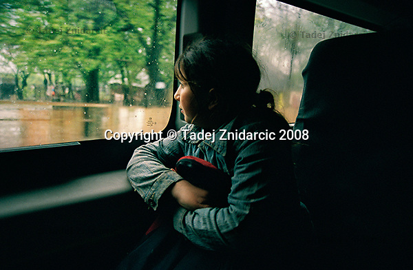 Girl rides home from a school in a van. She participates in an after-school program for disadvanteged Roma children. Balteni, Romania.