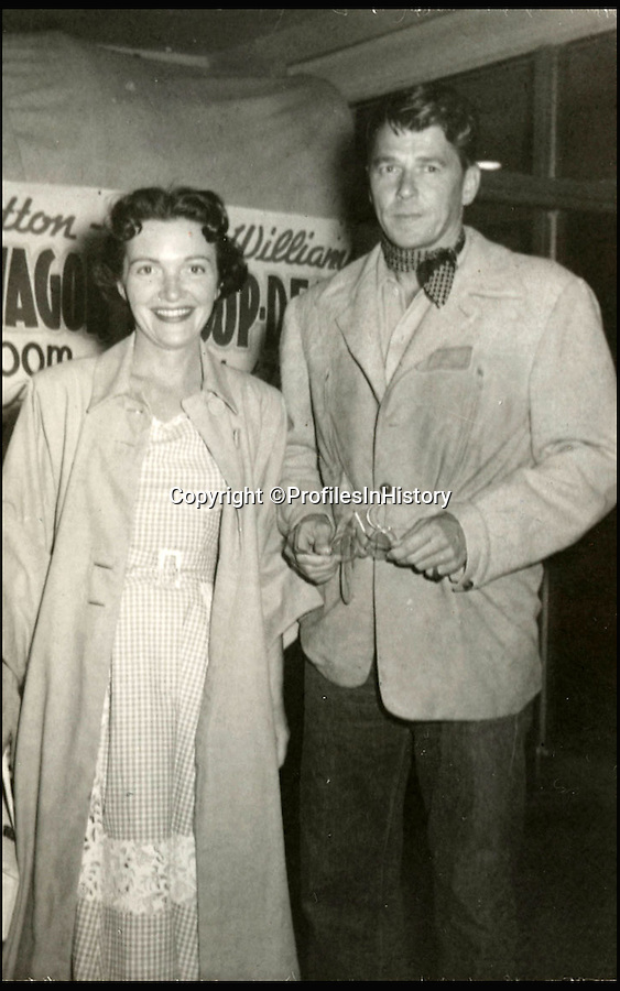 BNPS.co.uk (01202 558833)<br /> Pic: ProfilesInHistory/BNPS<br /> <br /> Reagan with second wife Nancy Davies in thw 1950's.<br /> <br /> An intimate album capturing hundreds of candid pictures of Ronald Reagan has emerged at auction with a presidential £100,000 price tag.  <br /> <br /> The vast archive follows the Republican icon from his early days in Hollywood, start of his political career and through his time in the White House. <br /> <br /> Away from the state dinners, film shoots and grandstanding these pictures offer a glimpse into his most private moments as he laughs with his young family.