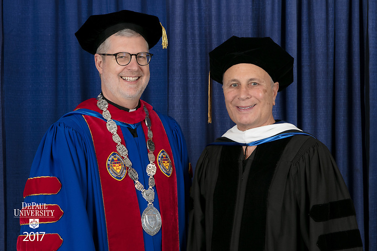 The Rev. Dennis H. Holtschneider, C.M., president of DePaul, left, and commencement speaker and honorary degree recipient John Corigliano, a Grammy Award-winning American composer. DePaul University School of Music and The Theatre School held its commencement ceremony, Saturday, June 10, 2017, during the DePaul University School of Music and The Theatre School commencement ceremony at the Rosemont Theatre in Rosemont, IL. (DePaul University/Jeff Carrion)