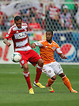 FC Dallas forward Fabian Castillo (7) and Houston Dynamo midfielder Corey Ashe (26) in action during the game between the FC Dallas and the Houston Dynamo at the FC Dallas Stadium in Frisco,Texas.