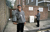 Bethnal Green Neighbourhood Wardens Sheikh Nanumiah and Doraj Miiah radio in to Tower Hamlets street cleansing department to report illegally dumped rubbish