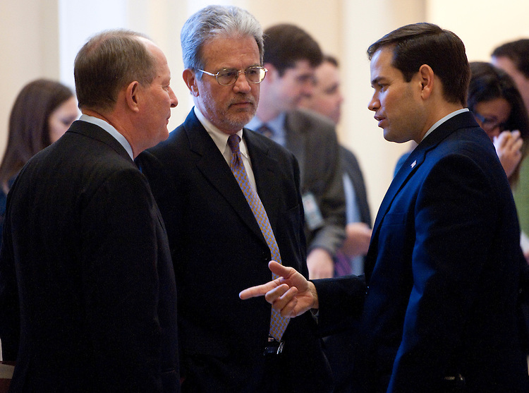 UNITED STATES - NOVEMBER 16: From left, Sen. Lamar Alexander, R-Tenn., Sen. Tom Coburn, R-Okla., and Sen.-elect Marco Rubio, R-Fla., talk outside of the Mansfield room as Senate Republicans gathered for their leadership elections on Tuesday, Nov. 16, 2010. (Photo By Bill Clark/Roll Call)