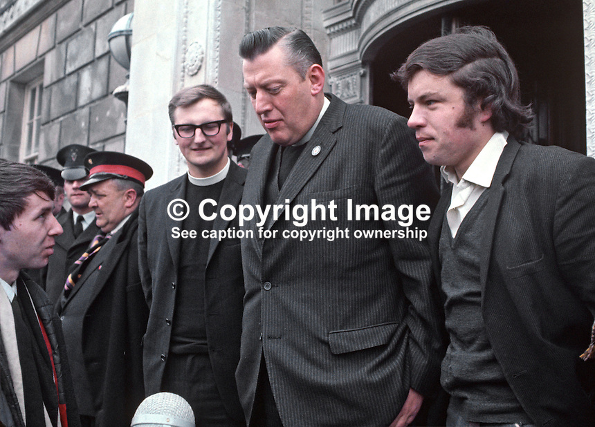 Protestant Unionist MPs, Rev Ian Paisley, accompanied by Rev William Beattie, arrive at Parliament Building, Stormont, to take their seats following by-election successes in Bannside and South Antrim. 197004210118a.<br />