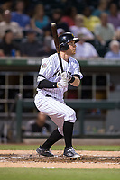 Cosy Asche (36) of the Charlotte Knights follows through on his swing against the Indianapolis Indians at BB&T BallPark on June 16, 2017 in Charlotte, North Carolina.  The Knights defeated the Indians 12-4.  (Brian Westerholt/Four Seam Images)