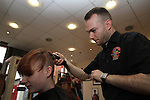 Alan Kennedy of Town Centre Barbers shaves Matilda George's head as part of the Shave or Die Charity Event...(Photo credit should read Jenny Matthews/NEWSFILE)...